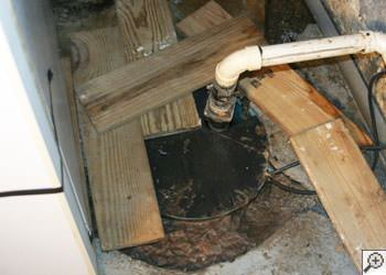 An ugly, clogged sump pump system in Holyoke, Massachusetts and Connecticut