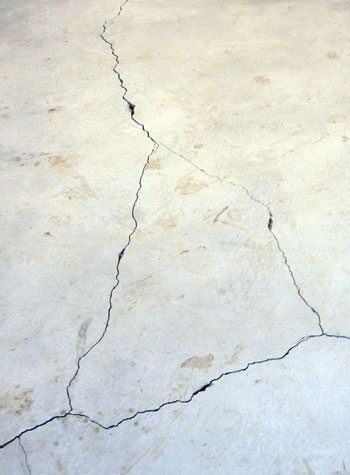 severely cracked, heaving slab floors in a home in Auburn