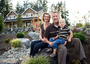 A happy family outside a home with a repaired foundation in Auburn