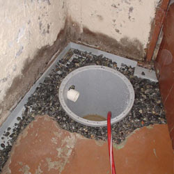 Installing a sump in a sump pump liner in a Chicopee home