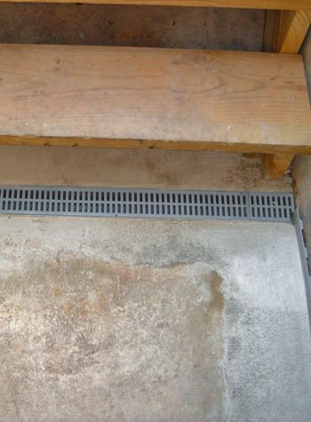 grated basement drain system for the end of staircases that leak