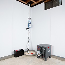 Sump pump system, dehumidifier, and basement wall panels installed during a sump pump installation in Gardner